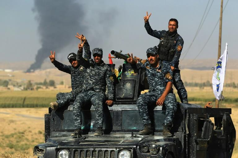 Iraqi government forces equipped with US weapons and vehicles have taken control of the rich oil fields around the Kurdish-claimed city of Kirkuk