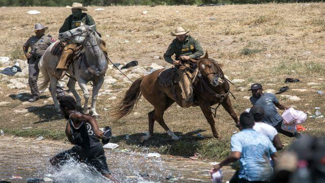Images of US Customs and Border Protection officers on horses, whipping migrants as they cross the Rio Grande from Ciudad Acuña, Mexico has sparked a new row, with the White House calling the images 'horrific'. AP