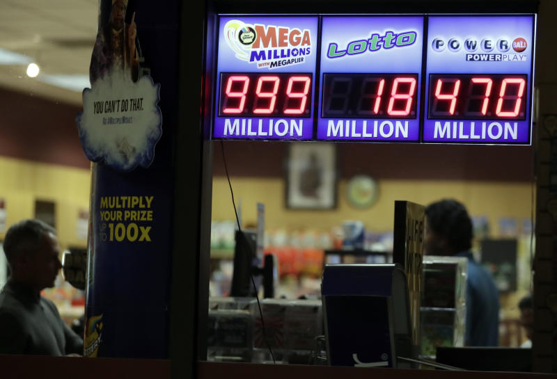 A sign displays the estimated Mega Millions jackpot at a convenience store in Chicago, Friday, Oct. 19, 2018. Friday's jackpot has soared to $1 billion, the second-largest prize in U. S. lottery history. (AP Photo/Nam Y. Huh)