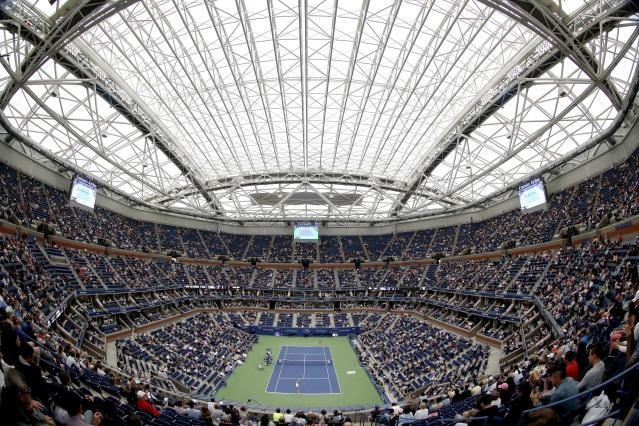 FILE- In this Sept. 6, 2017, file photo, fans fill the stands at Arthur Ashe stadium as Karolina Pliskova, of Czech Republic, plays CoCo Vandeweghe, of the United States, during the quarterfinals of the U.S. Open tennis tournament in New York. Governor Andrew Cuomo announced, Tuesday, June 16, 2020, that the U.S. Open will be played in Queens from Aug. 31 to Sept. 13, but without fans in attendance. (AP Photo/Adam Hunger, File)