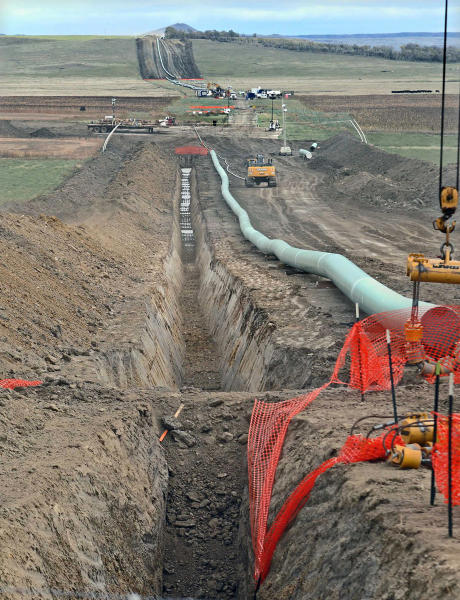 FILE - In this October 2016, file photo, construction continues on the Dakota Access Pipeline. A federal judge on Wednesday, March 25, 2020, ordered the U.S. Army Corps of Engineers to conduct a full environmental review of the Dakota Access pipeline, nearly three years after it began carrying oil.(Tom Stromme/The Bismarck Tribune via AP, File)