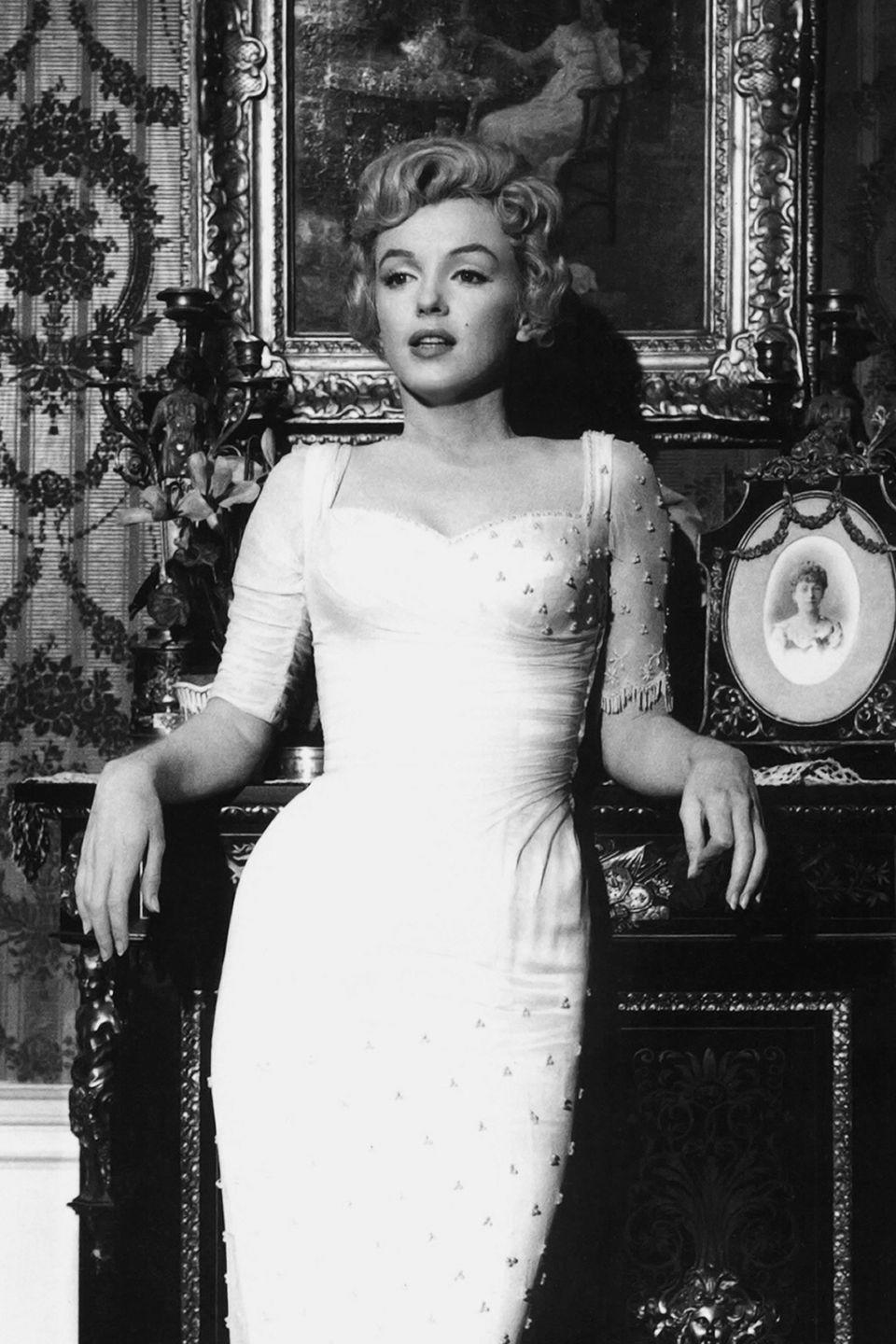 <p>Monroe in costume filming <em>The Prince and the Showgirl, </em>in which she costarred with Sir Lawrence Olivier. </p>