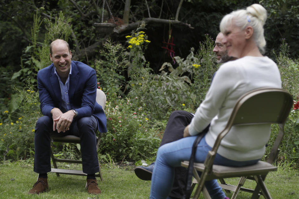 EMBARGOED TO 2200 SATURDAY JULY 18 The Duke of Cambridge speaks with service user Regina Paskovskaja (right) and Chief Executive Steven Pettican during a visit to the Garden House part of the Peterborough Light Project, a charity which offers advice and support to rough sleepers.