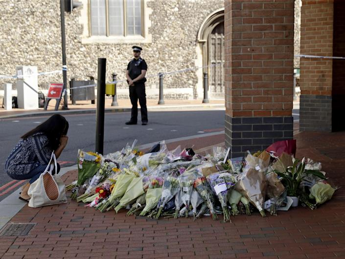 <p>Floral tributes in Forbury Gardens, Reading, where the attack happened in June 2020</p> (AP)