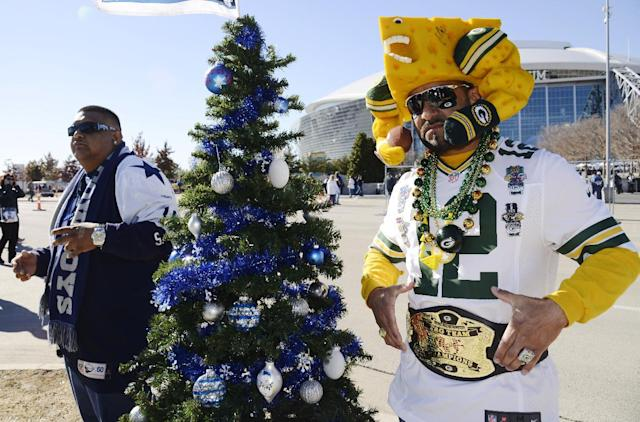 Henry Morales, left, and Richard Llanes pose for a picture before an NFL football game between the Dallas Cowboys and the Green Bay Packers, Sunday, Dec. 15, 2013, in Arlington, Texas. (AP Photo/Tim Sharp)