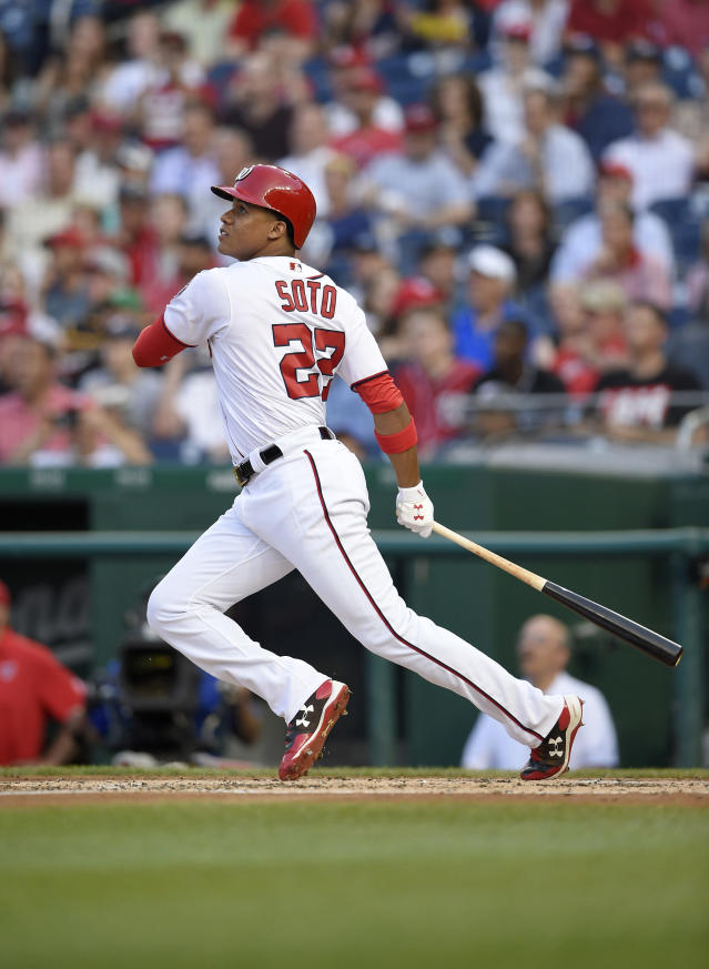 Washington Nationals' Juan Soto watches his three-run home run during the second inning of a baseball game against the San Diego Padres, Monday, May 21, 2018, in Washington. This was his first major league hit. (AP Photo/Nick Wass)