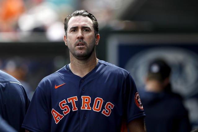 Houston Astros pitcher Justin Verlander walks in the dugout after pitching to the St. Louis Cardinals in the first inning of a spring training baseball game, Tuesday, March 3, 2020, in Jupiter, Fla. (AP Photo/Julio Cortez)