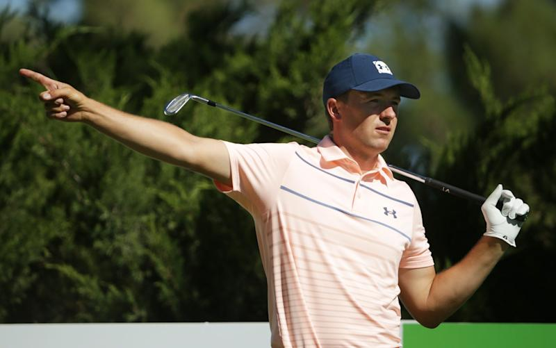 Jordan Spieth signals a wayward shot off the tee - GETTY IMAGES