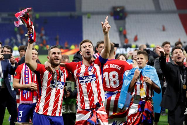 Soccer Football - Europa League Final - Olympique de Marseille vs Atletico Madrid - Groupama Stadium, Lyon, France - May 16, 2018 Atletico Madrid's Gabi and Koke celebrate after winning the Europa League REUTERS/Gonzalo Fuentes