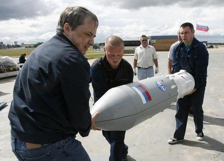 Workers carry a part of a Russian Angara rocket to put it on display as they prepare for the MAKS-2009 international air show in Zhukovsky