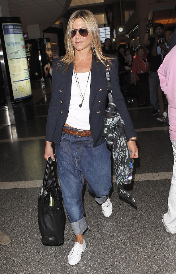 "Here's former ""Friends"" star Jennifer Aniston unsuccessfully attempting to rock a pair of men's jeans (perhaps bf Justin Theroux's) while walking through LAX. Has there ever been a bigger crotch-based catastrophe in fashion history? We think not. (6/9/2012)<br><br><a target=""_blank"" href=""http://www.x17online.com/celebrities/jennifer_aniston/"">Check out more pics of Jennifer Aniston over at X17!</a>"