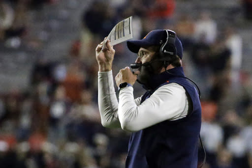 Auburn coach Gus Malzahn signals to his players during the first half of the team's NCAA college football game against Tennessee on Saturday, Nov. 21, 2020, in Auburn, Ala. (AP Photo/Butch Dill)