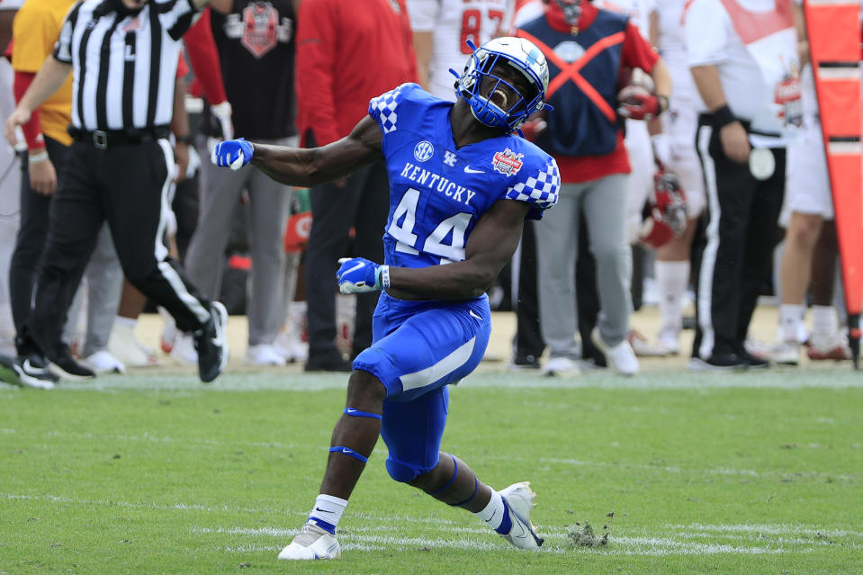 JACKSONVILLE, FLORIDA - JANUARY 02: Jamin Davis #44 of the Kentucky Wildcats celebrates a defensive stop against the North Carolina State Wolfpack during the TaxSlayer Gator Bowl at TIAA Bank Field on January 02, 2021 in Jacksonville, Florida. (Photo by Sam Greenwood/Getty Images)