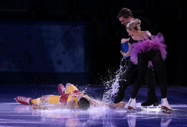 Javier Fernandez of Spain, left, has water poured over him by Kirsten Moore-Towers and Dylan Moscovitch of Canada as they perform during the figure skating exhibition gala at the Iceberg Skating Palace during the 2014 Winter Olympics, Saturday, Feb. 22, 2014, in Sochi, Russia. (AP Photo/Ivan Sekretarev)
