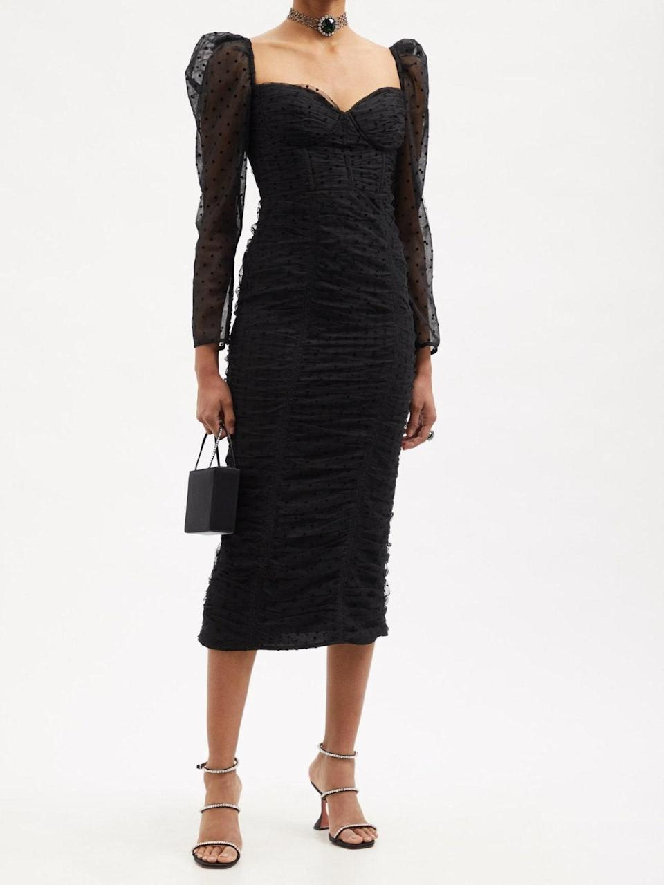 """Leave to Self-Portrait to bless us with yet another effortless-to-style piece. From the ruching to the sweetheart neckline and tulle puff sleeves, this is one black dress you'll never get bored of. $300, Matches Fashion. <a href=""""https://www.matchesfashion.com/us/products/Self-Portrait-Sweetheart-ruched-Swiss-dot-tulle-midi-dress-1436930"""" rel=""""nofollow noopener"""" target=""""_blank"""" data-ylk=""""slk:Get it now!"""" class=""""link rapid-noclick-resp"""">Get it now!</a>"""