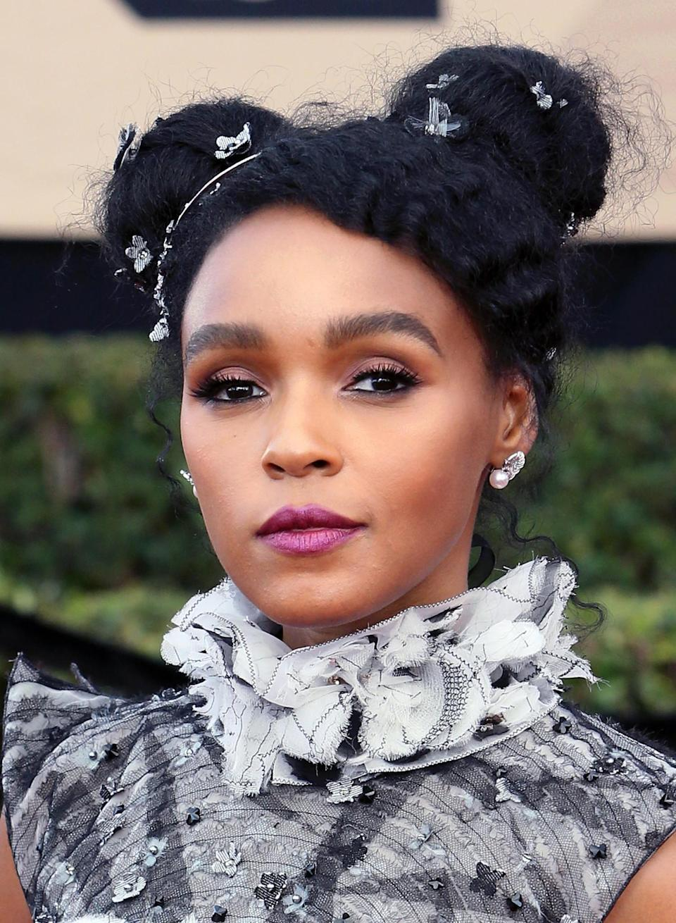 <p>Monoe's hair was ON-POINT! The actress looked stunning with her embellished buns and a bold purple lip. [Photo: Getty] </p>