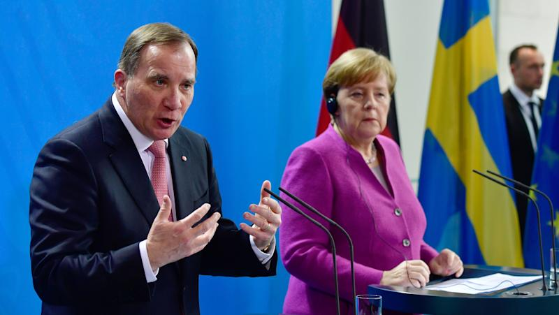 German Chancellor Angela Merkel and Sweden's Prime Minister Stefan Löfven give a joint press conference on March 16, 2018 in Berlin. (JOHN MACDOUGALL via Getty Images)