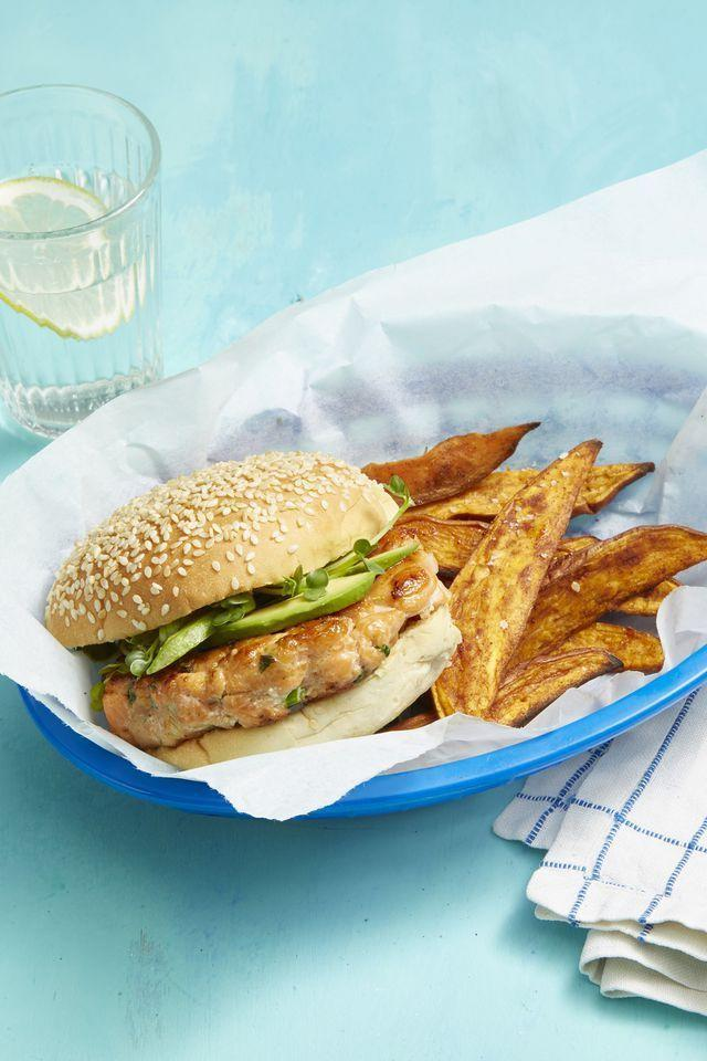 """<p>Here's a burger option for the pescetarians out there. A food processor transforms salmon, soy sauce, scallions, and sesame oil into beautiful patties that cook up quickly on the stove.</p><p><em><a href=""""https://www.womansday.com/food-recipes/food-drinks/a21053153/salmon-burgers-and-five-spice-sweet-potato-fries-recipe/"""" rel=""""nofollow noopener"""" target=""""_blank"""" data-ylk=""""slk:Get the recipe for Salmon Burgers and Five-Spice Sweet Potato Fries"""" class=""""link rapid-noclick-resp"""">Get the recipe for Salmon Burgers and Five-Spice Sweet Potato Fries</a></em></p>"""
