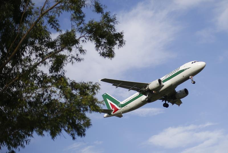 An Alitalia plane approaches to land at Fiumicino international airport in Rome