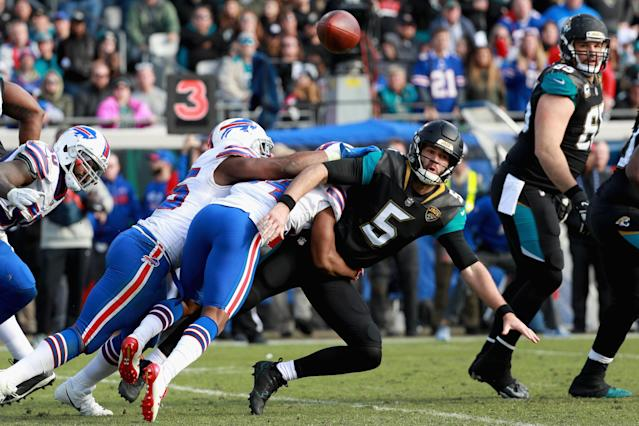 <p>Quarterback Blake Bortles #5 of the Jacksonville Jaguars gets a pass off while being hit by the Buffalo Bills defense in the fourth quarter during the AFC Wild Card Playoff game at EverBank Field on January 7, 2018 in Jacksonville, Florida. (Photo by Scott Halleran/Getty Images) </p>