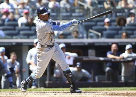 Jun 17, 2018; Bronx, NY, USA; Tampa Bay Rays left fielder Carlos Gomez (27) hits a single in the fourth inning against the New York Yankees at Yankee Stadium. Mandatory Credit: Wendell Cruz-USA TODAY Sports