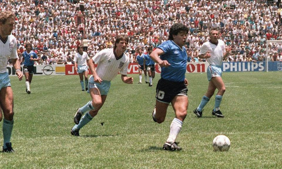 Maradona runs past Terry Butcher and Terry Fenwick on his way to scoring his second goal against England in 1986