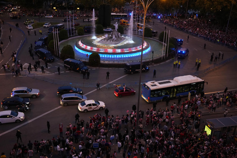 The Neptuno fountain is illuminated with the colours of Atletico Madrid as their supporters celebrate their team's Spanish La Liga title in Madrid, Saturday, May 22, 2021. Atletico clinches its 11th Spanish La Liga title. (AP Photo/Paul White)