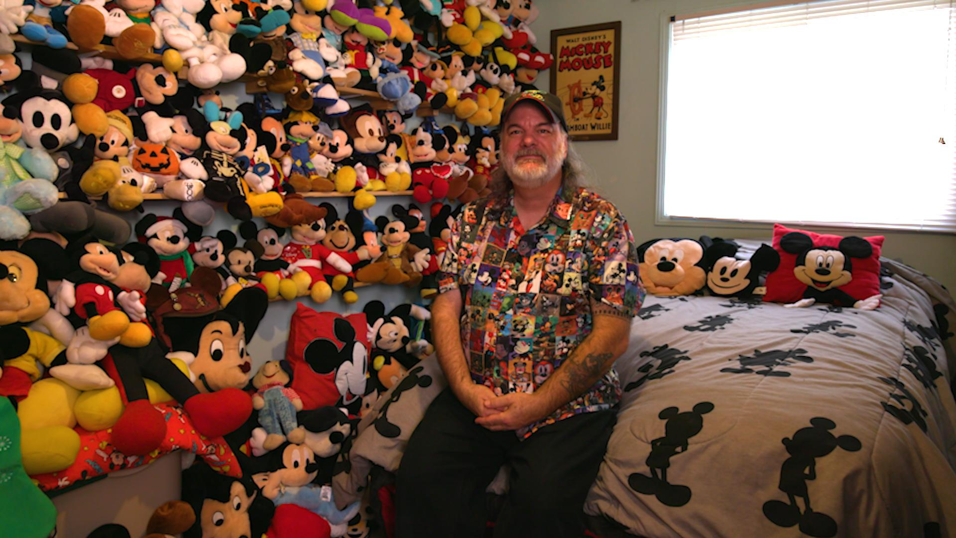 Bottos with just a portion of his plush Mickeys. (Photo: Yahoo Lifestyle)