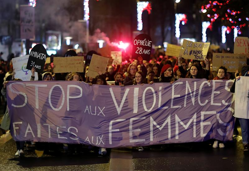 Demonstrators carry signs and banners to protest femicide and violence against women in Nantes, France, November 25, 2019. REUTERS/Stephane Mahe