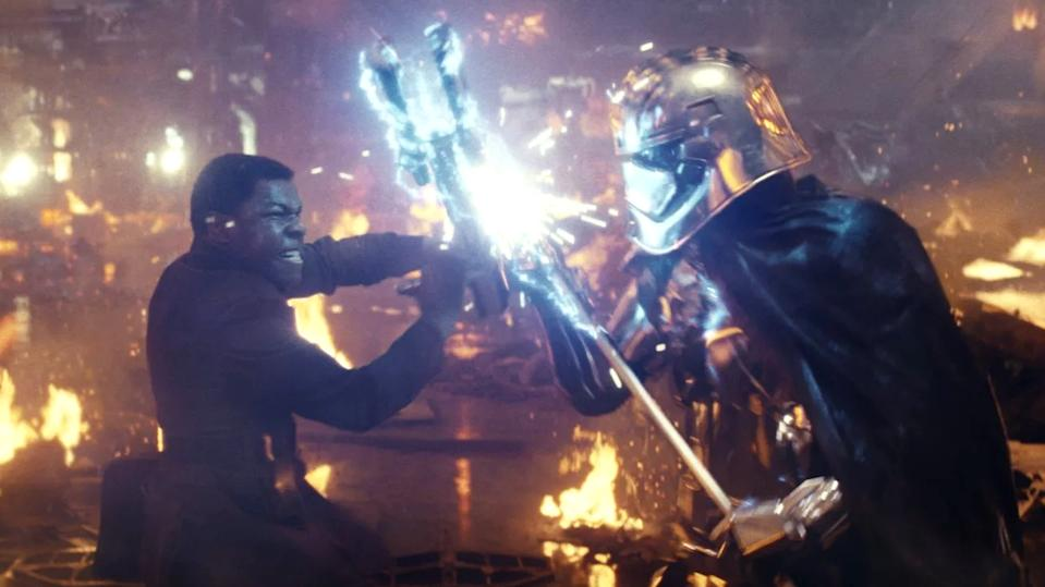 John Boyega and Gwendoline Christie fight to the death in 'Star Wars: The Last Jedi'. (Credit: Disney)