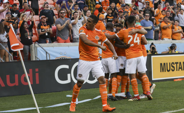 Houston Dynamo forward Mauro Manotas (9) celebrates a goal by Alberth Elis against the Vancouver Whitecaps during the first half of an MLS soccer match Saturday, March 10, 2018, in Houston. (Yi-Chin Lee/Houston Chronicle/via AP)