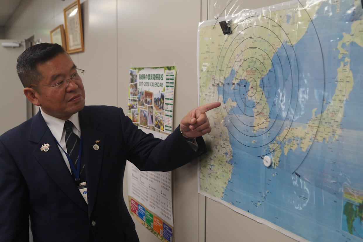 Hiroharu Aoki, the director of the Crisis Management Division in Nagasaki Prefecture, looks at a map in his office that shows the range of North Korean missiles. (Photo: Michael Walsh/Yahoo News)