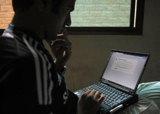 A Pakistani resident uses a computer to try to enter social networking website Twitter