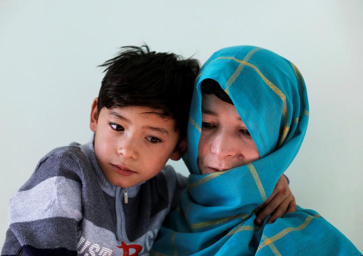 Murtaza Ahmadi, 7, an Afghan Lionel Messi fan and his mother Shafiqa Ahmadi, 38, pose for a picture at their house in Kabul, Afghanistan December 8, 2018.REUTERS/Mohammad Ismail