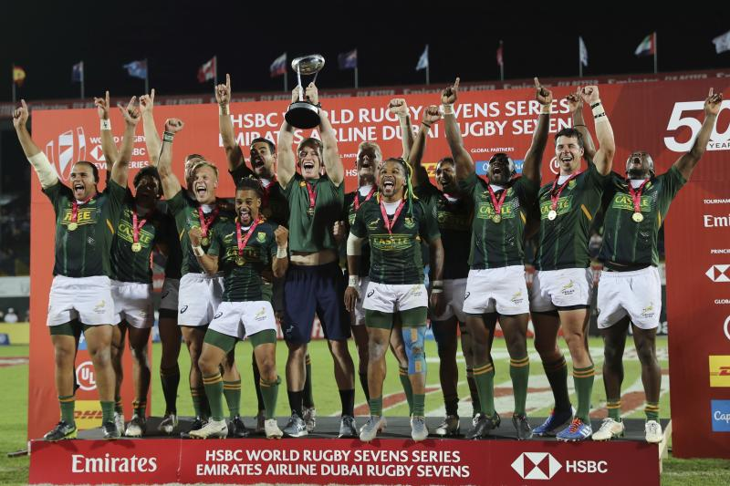 South Africa's players celebrate with the trophy after they defeated New Zealand in the final match of the Emirates Airline Rugby Sevens in Dubai, United Arab Emirates, Saturday, Dec.7, 2019. (AP Photo/Kamran Jebreili)