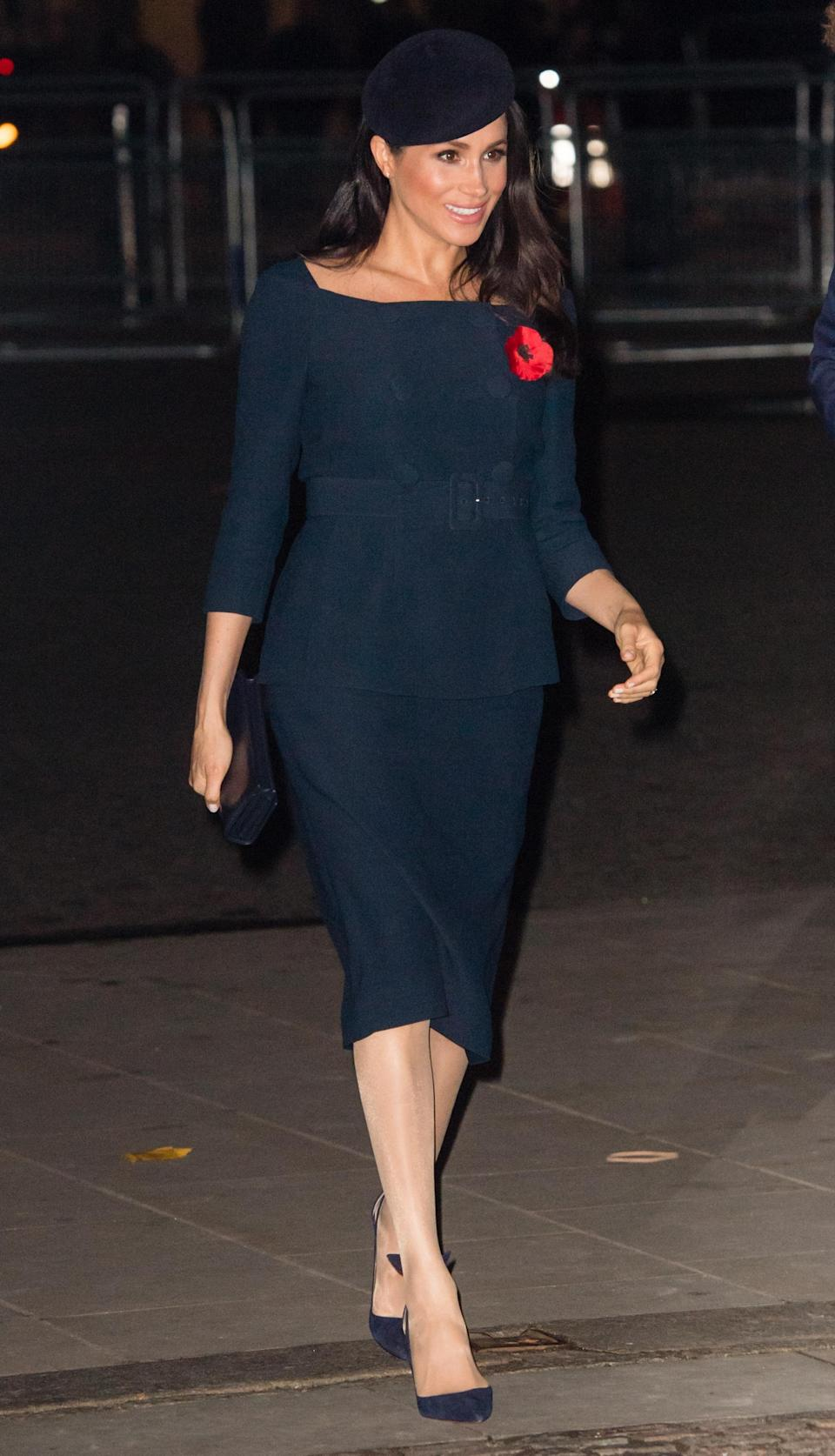 <p>Meghan chose a Stella McCartney coat and navy cold-shoulder co-ord for a Westminster Abbey service. She accessorised the look with a matching beret, Stella McCartney clutch and Manolo Blahnik heels. <em>[Photo: Getty]</em> </p>