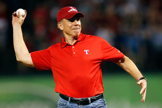 ARLINGTON, TX - OCTOBER 24: Dallas Cowboys Hall of Fame quarterback Roger Staubach throws out the ceremonial first pitch prior to Game Five of the MLB World Series between the St. Louis Cardinals and the Texas Rangers at Rangers Ballpark in Arlington on October 24, 2011 in Arlington, Texas. (Photo by Tom Pennington/Getty Images)