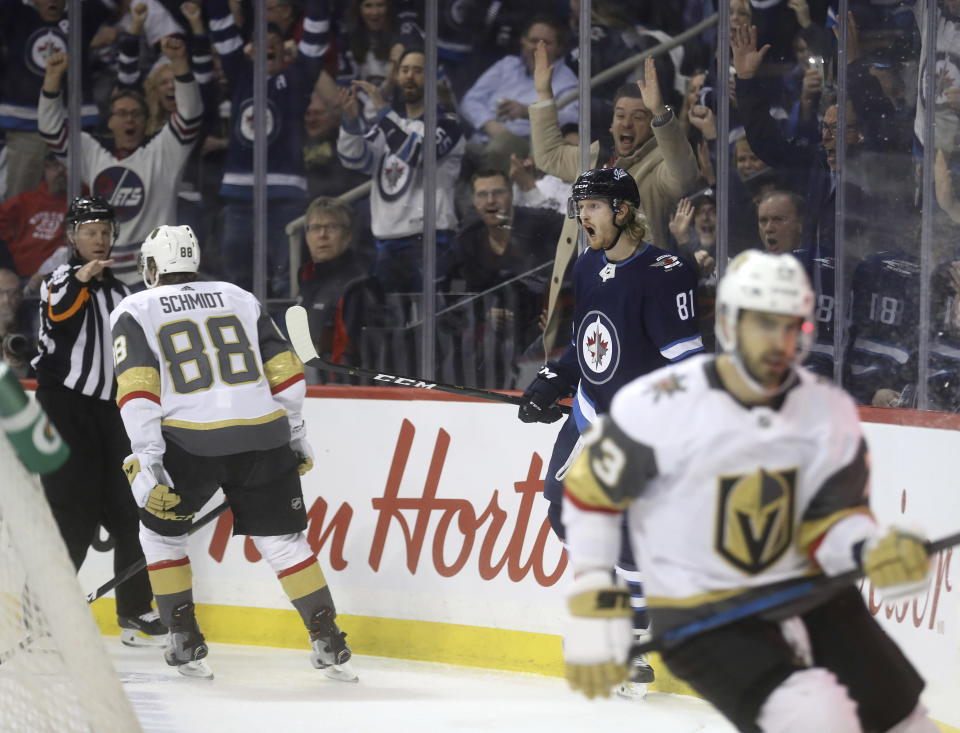 Winnipeg Jets' Kyle Connor (81) celebrates after scoring against the Vegas Golden Knights' as Nate Schmidt (88) and Brandon Pirri (73) react during the second period of an NHL hockey game Tuesday, Jan. 15, 2019, in Winnipeg, Manitoba. (Trevor Hagan/The Canadian Press via AP)