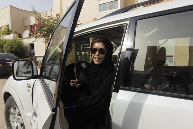 Azza Al Shmasani alights from her car after driving in defiance of the ban in Riyadh on June 22, 2011. (Fahad Shadeed / Reuters)