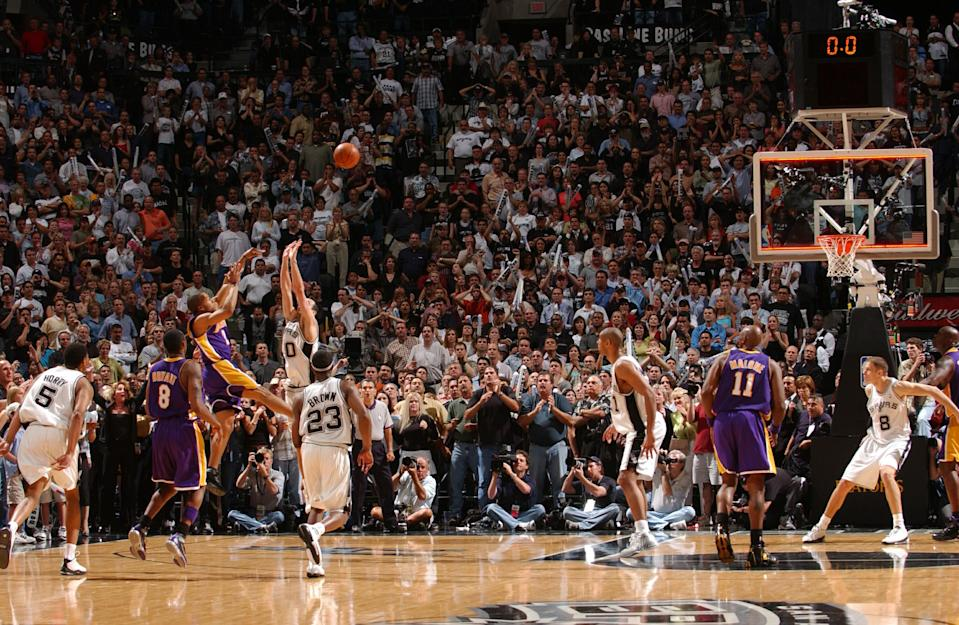 """<a class=""""link rapid-noclick-resp"""" href=""""/nba/teams/la-lakers/"""" data-ylk=""""slk:Lakers"""">Lakers</a> guard Derek Fisher beat the buzzer by an instant, but the Spurs maintain he did not beat the clock. (Andrew D. Bernstein/NBAE via Getty Images)"""