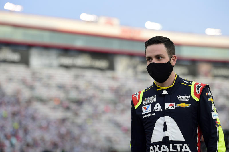BRISTOL, TENNESSEE - SEPTEMBER 19: Alex Bowman, driver of the #88 Axalta Chevrolet, stands on the grid prior to the NASCAR Cup Series Bass Pro Shops Night Race at Bristol Motor Speedway on September 19, 2020 in Bristol, Tennessee. (Photo by Jared C. Tilton/Getty Images)