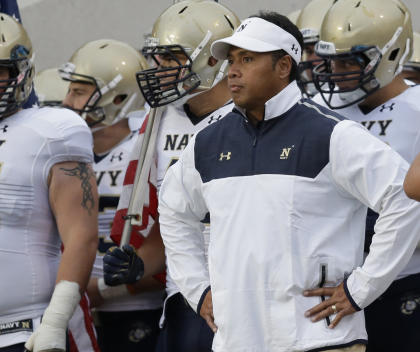 FILE - This Sept. 13, 2014, file photo shows Navy head coach Ken Niumatalolo standing with his team prior to an NCAA college football game against Texas State in San Marcos, Texas. With a victory over Army on Saturday, Ken Niumatalolo will become the winningest football coach in Navy history. Now in his seventh season at the Academy, Niumatalolo is 55-35. He passed his predecessor, Paul Johnson, on the win list last year and is currently tied with George Welsh, a member of the College Football Hall of Fame who went 55-46-1 from 1973-81.(AP Photo/Eric Gay, File)