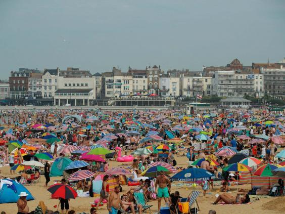 People enjoy the hot weather on Margate beach (Reuters)