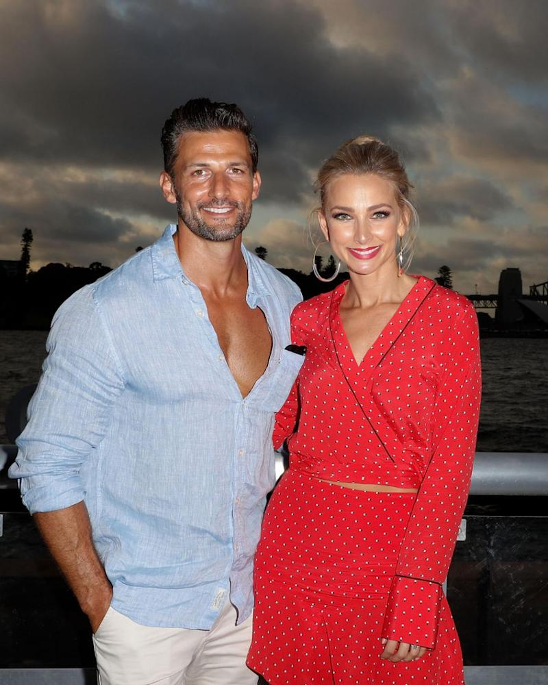 Tim, here with fiancée Anna Heinrich, has said if his bucks party is a big one it needs to be in an 'isolated place'. Source: Getty