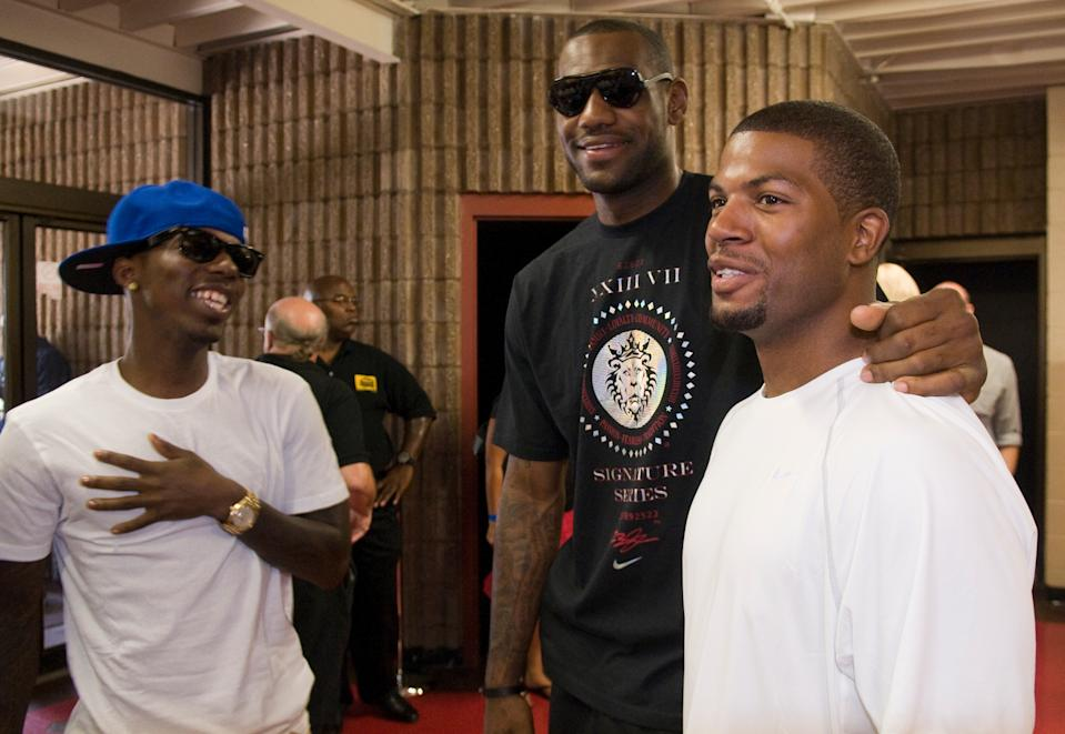 Cleveland Cavaliers forward LeBron James, center, talks with Rich Paul, left, and former high school teammate Brandon Weems, right, before an event where James revealed his new Nike Air Max LeBron VII shoes during an event at Ed Davis Community Center in Akron, Ohio on Friday, Aug. 7, 2009 in Cleveland, Ohio. (AP Photo/Jason Miller)