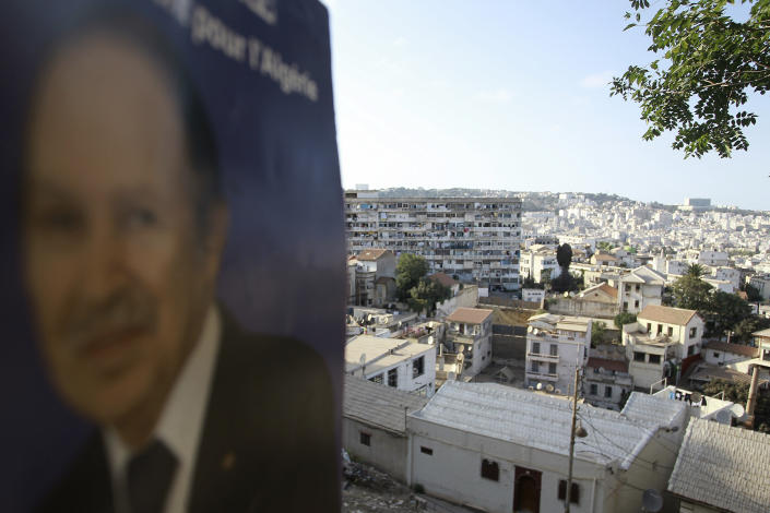 A portrait of former Algerian President Abdelaziz Bouteflika is pictured on the heights of Algiers, Saturday, Sept. 18, 2021. Algeria's leader declared a three-day period of mourning starting Saturday for former President Abdelaziz Bouteflika, whose 20-year-long rule, riddled with corruption, ended in disgrace as he was pushed from power amid huge street protests when he decided to seek a new term. Bouteflika, who had been ailing since a stroke in 2013, died Friday at 84. (AP Photo/Fateh Guidoum)