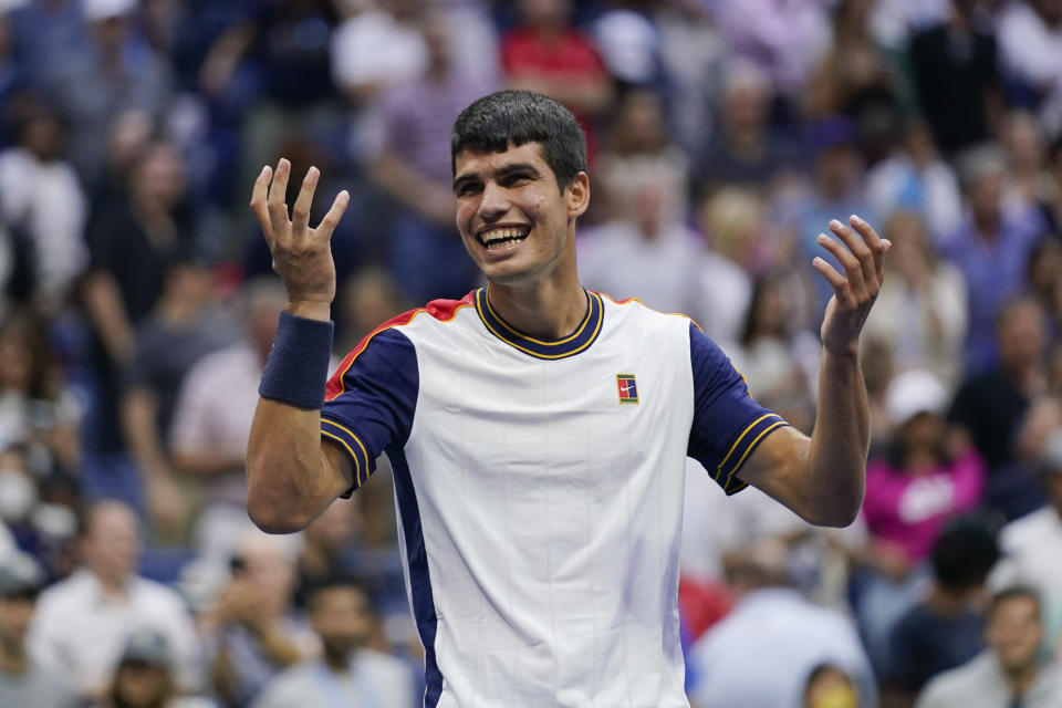 Carlos Alcaraz, of Spain, reacts after defeating Stefanos Tsitsipas, of Greece, during the third round of the US Open tennis championships, Friday, Sept. 3, 2021, in New York. (AP Photo/Seth Wenig)
