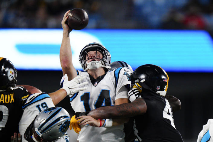 Carolina Panthers quarterback Sam Darnold tries to pass under pressure form Pittsburgh Steelers linebacker Robert Spillane during the first half of a preseason NFL football game Friday, Aug. 27, 2021, in Charlotte, N.C. (AP Photo/Jacob Kupferman)