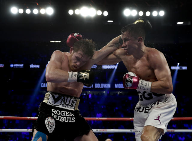 Canelo Alvarez, left, and Gennady Golovkin trade punches in the fourth round during a middleweight title boxing match, Saturday, Sept. 15, 2018, in Las Vegas. (AP Photo/Isaac Brekken)