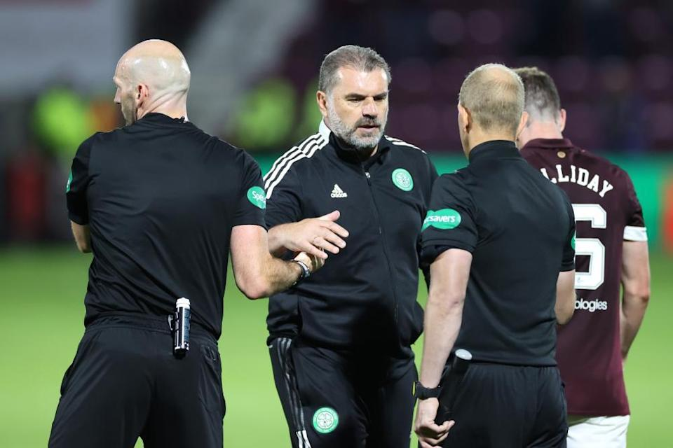 Ange Postecoglou shakes hands with officials after Celtic's defeat at Tynecastle.
